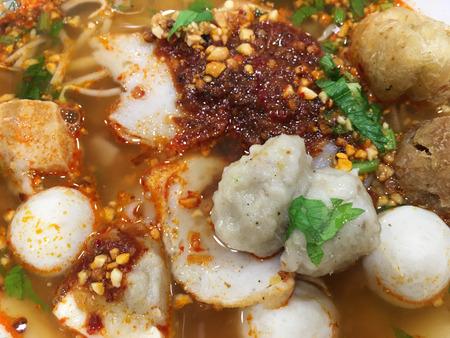 thai noodle soup: tom yum soup with fish balls, Thai cuisine