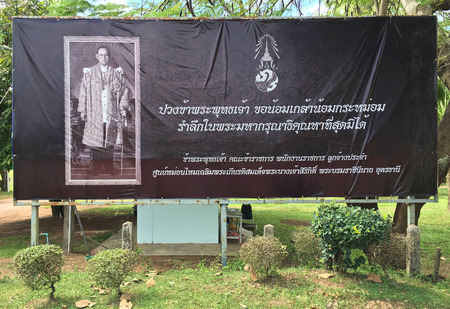 UDON THANI, THAILAND - OCT. 31, 2016: A mourning board with the portrait of Bhumibol Adulyadej (1927 – 2016), the monarch of Thailand as Rama IX. He was the worlds longest serving head of state. Editorial