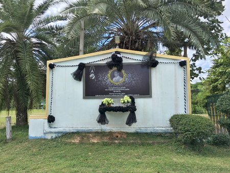 UDON THANI, THAILAND - OCTOBER 31, 2016: A mourning board with the portrait of Bhumibol Adulyadej (1927 – 2016), the king of Thailand as Rama IX. He was the worlds longest serving head of state.