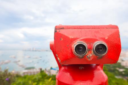 old red binoculars at an observation deck