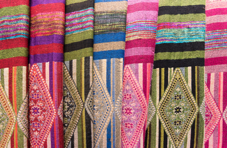 sciarpe: Scarves with Hmong ethnical patterns. Hmongs are an ethnic group from the mountainous regions of China, Vietnam, Laos, and Thailand.