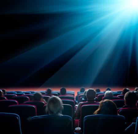viewers watch shining star at cinema, long exposure, blue glow Foto de archivo