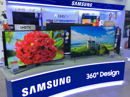 samsung: VUNG TAU, VIETNAM - DECEMBER 25, 2016: Samsung televisions at the Nguyen Kim store. Samsung Electronics Co., Ltd. is the worlds second largest information technology company by revenue, after Apple.