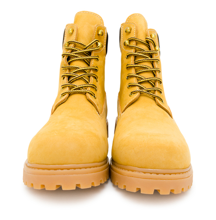 yellow suede boots, isolated over white background