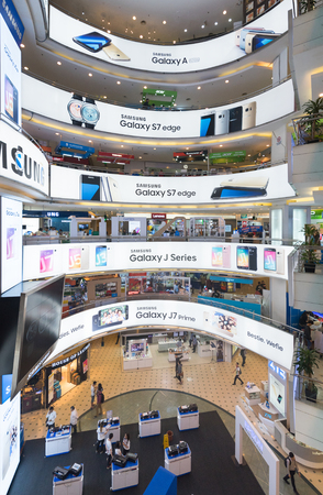 yat: KUALA LUMPUR - MARCH 13, 2017: Samsung advertisement banners on each floor of Plaza Low Yat. Samsung Electronics is the worlds second largest information technology company by revenue, after Apple. Editorial