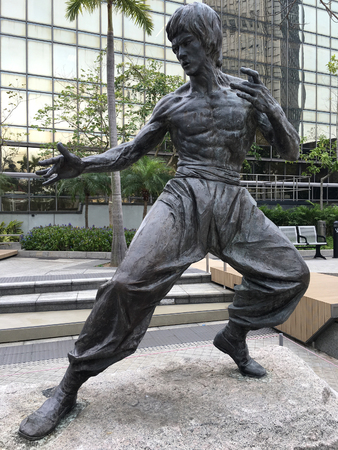 temporarily: HONG KONG - MARCH 16, 2017: Bruce Lee statue is temporarily located in the Garden of Stars from Avenue of Stars which is closed off for three years while its redevelopment and expansion is undertaken.