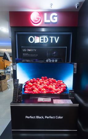 yat: KUALA LUMPUR - MARCH 13, 2017: An LG OLED TV store in Low Yat Plaza. LG Corporation is a South Korean multinational conglomerate corporation being the fourth largest one in South Korea.