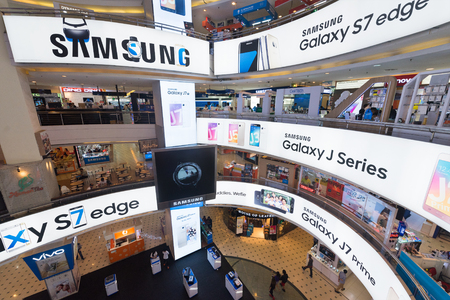yat: KUALA LUMPUR - MAR 13, 2017: Samsung advertisement banners on each floor of Plaza Low Yat. Samsung Electronics is the worlds second largest information technology company by revenue, after Apple.