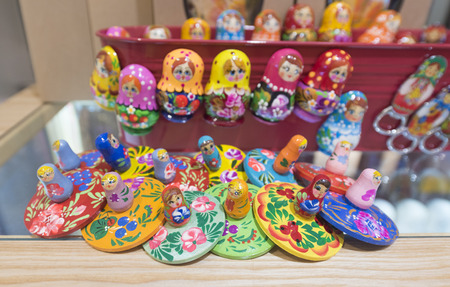 russian souvenirs, wooden painted russian dolls for sale Editorial