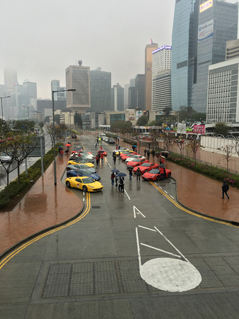 shiny car: HONG KONG, CHINA - MARCH 17, 2017: View of Ferrari cars at the streets of Hong Kong city. Ferrari road cars are generally seen as a symbol of speed, luxury and wealth.