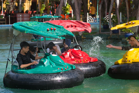 HO CHI MINH CITY, VIETNAM - JULY 19, 2017: People have fun on round boats in the Dai Nam amusement park 40 km away from the city. The park is very large occupying the territory of 450 hectares.