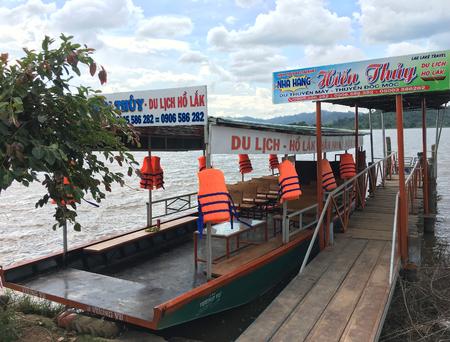 LIEN SON, VIETNAM - JUNE 30 2017: An empty tour boat at Lak Lake in Lien Son, a commune and village in Dak Lak Province in northeastern Vietnam. Editorial