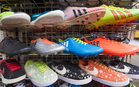 KUALA LUMPUR - MARCH 14, 2017: Various counterfeit sports shoes for sale at the Chinatown market known as Petaling Street. It is famous with its budget hotels and food.