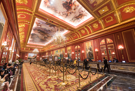 MACAU, CHINA - SEPT 15, 2017: Tourists at the Parisian hotel reception hall. Macaus gaming revenue has been the worlds largest since 2006 with the economy heavily dependent on gaming and tourism