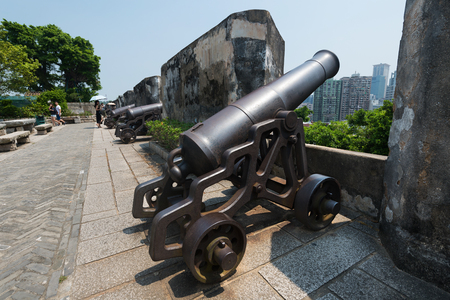 MACAU - SEPTEMBER 2017: Ancient cannons by the wall of Monte Fort. Fortaleza do Monte is a fort in Santo Antonio. It is the historical military centre of Macau. Stok Fotoğraf - 89895869