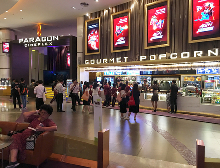 BANGKOK - DECEMBER 2017: Unidentified people buy food at a snack bar of Paragon Cineplex in the Siam Paragon shopping mall. With 16 screens and 5,000 seats, it is Thailands largest movie theater. Editorial