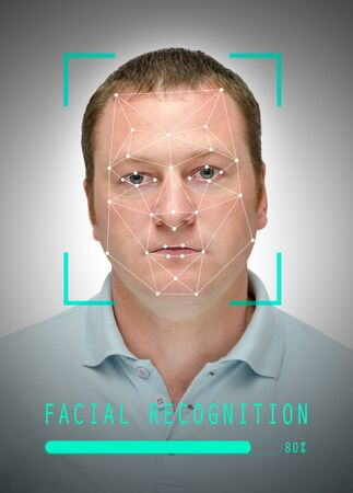 serious caucasian man with facial recognition frame, closeup Stockfoto
