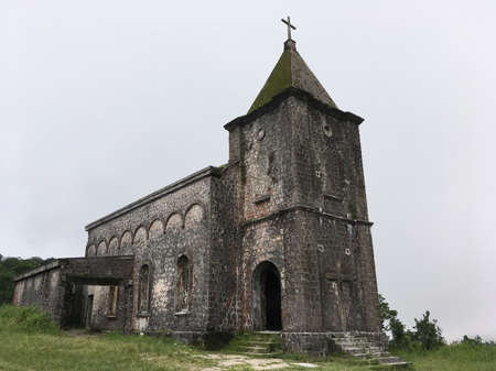 A ruined old catholic church at Bokor mountain near Kampot in Cambodia. The mountain used to be a French colonial hill station resort and site of a royal summer vacation home. 版權商用圖片