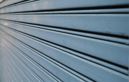 shutter door: Unusual view of steel shutter door Stock Photo