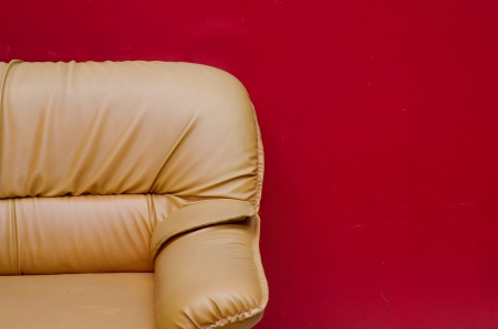 relax leather sofa with red wall photo