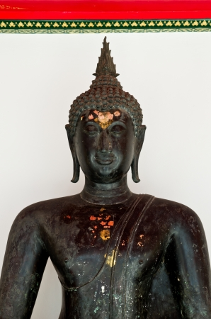 black Thai Buddha statue in Thai temple photo