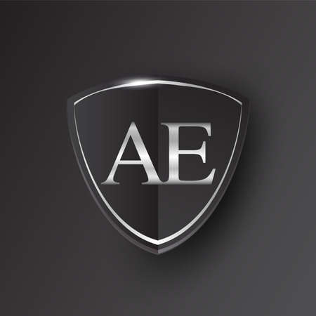Initial logo letter AE with shield Icon silver color isolated on black background, logotype design for company identity. Illusztráció
