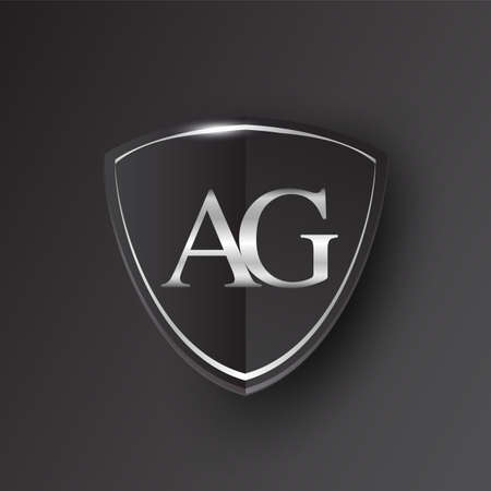 Initial logo letter AG with shield Icon silver color isolated on black background, logotype design for company identity.
