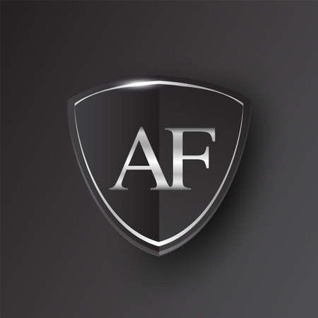 Initial logo letter AF with shield Icon silver color isolated on black background, logotype design for company identity.