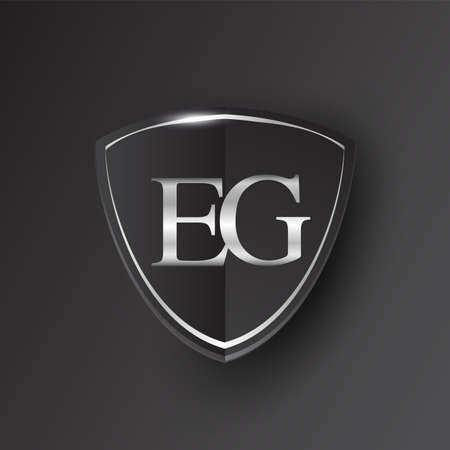Initial logo letter EG with shield Icon silver color isolated on black background, logotype design for company identity.