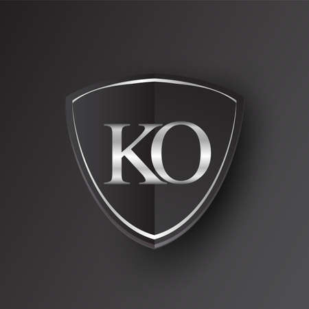 Initial logo letter KO with shield Icon silver color isolated on black background, logotype design for company identity.