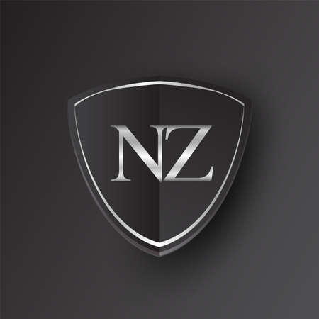 Initial logo letter NZ with shield Icon silver color isolated on black background, logotype design for company identity. Illusztráció