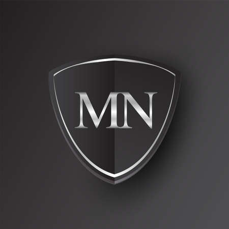 Initial logo letter MN with shield Icon silver color isolated on black background, logotype design for company identity.