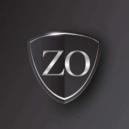Initial logo letter ZO with shield Icon silver color isolated on black background, logotype design for company identity.