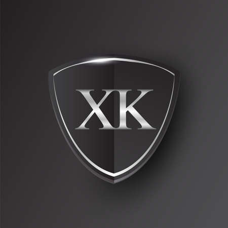 Initial logo letter XK with shield Icon silver color isolated on black background, logotype design for company identity.