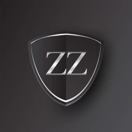 Initial logo letter ZZ with shield Icon silver color isolated on black background, logotype design for company identity.