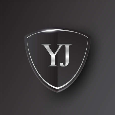 Initial logo letter YJ with shield Icon silver color isolated on black background, logotype design for company identity. Illusztráció