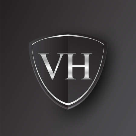 Initial logo letter VH with shield Icon silver color isolated on black background, logotype design for company identity. Illusztráció