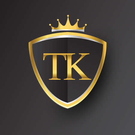 Initial logo letter TK with shield and crown Icon golden color isolated on black background, logotype design for company identity. Logó