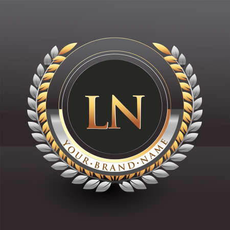 Initial logo letter LN with golden and silver color with laurel and wreath, vector logo for business and company identity.