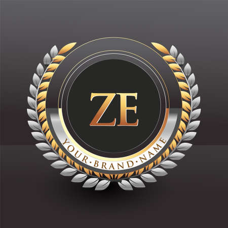 Initial logo letter ZE with golden and silver color with laurel and wreath, vector logo for business and company identity.