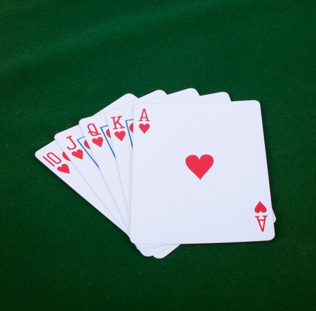 straight flush: A royal straight flush playing cards poker hand in hearts