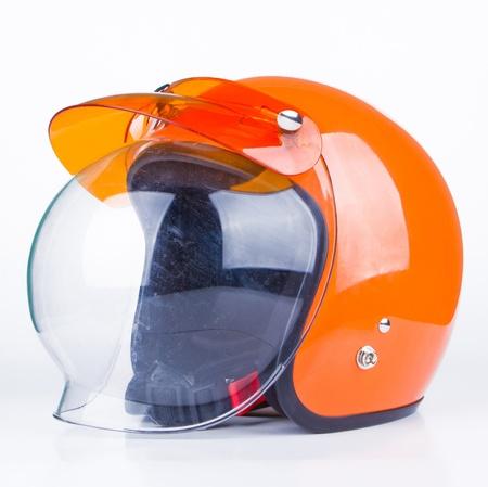casco rojo: Retro casco en un fondo blanco Foto de archivo
