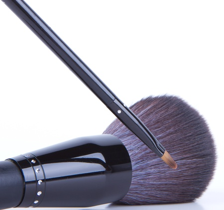 Set of black make-up brushes on white background photo