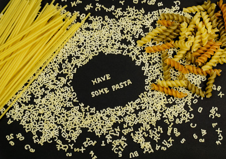 health concern: Have Some Pasta sign spelled using pasta letters with other type of pasta on the side