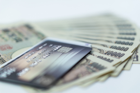 credit cards with background of cash in Japanese Yen