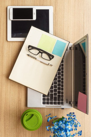 homeoffice: Notebook on a home-office wooden working desk, top view Stock Photo