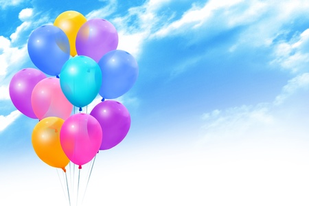 Bunch colored balloons on a on blue sky photo