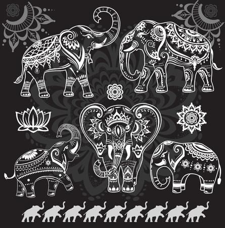 Set van versierde olifanten op zwart Vector Illustratie