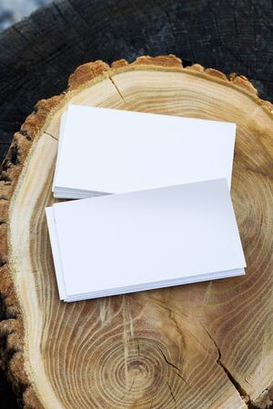 Photo of blank business cards on a wooden background Branding mockup Template for ID
