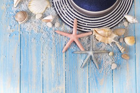 Background of seashells, starfishes and Beach hat